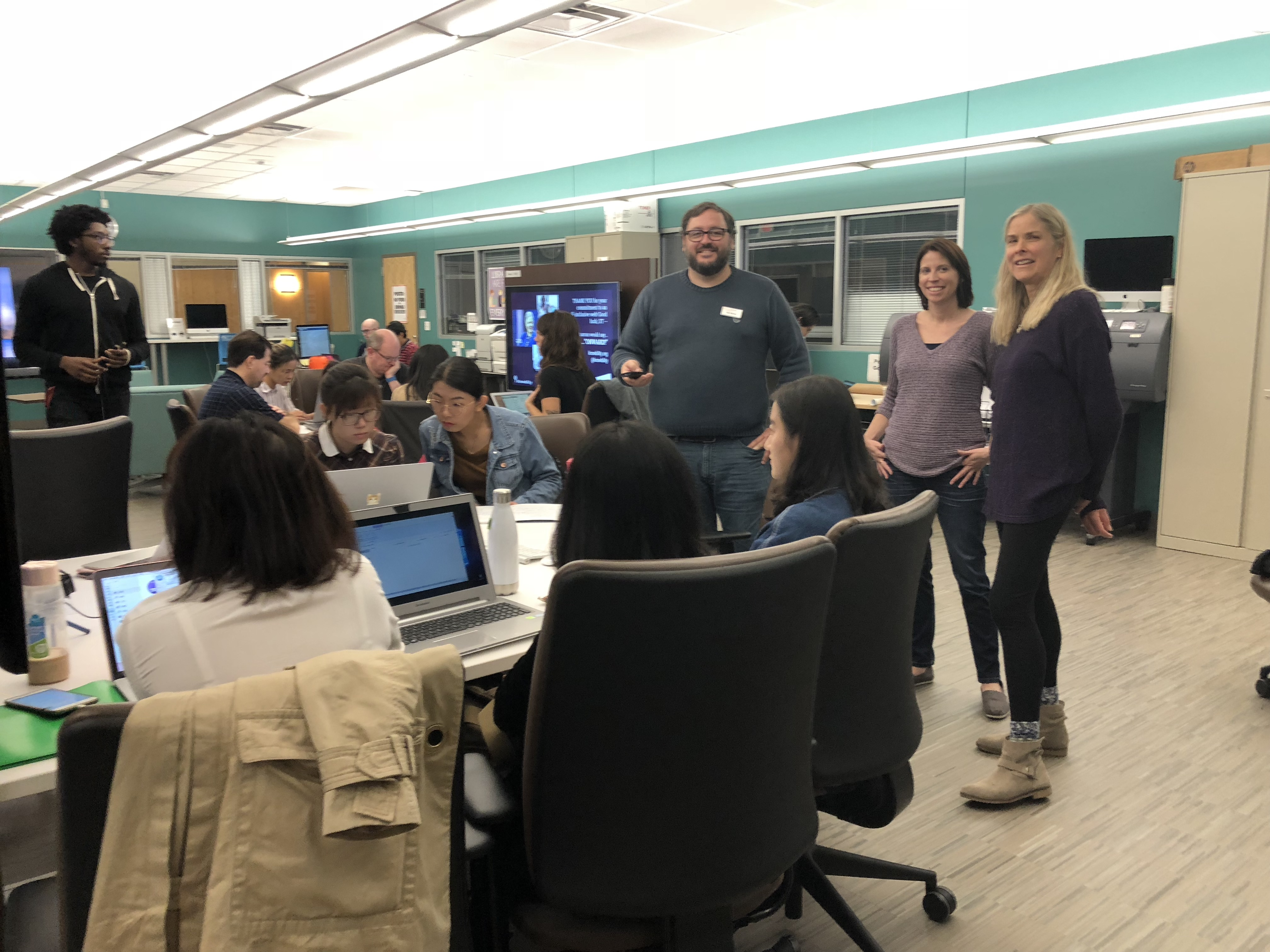 Student volunteer teams working in a computer lab.