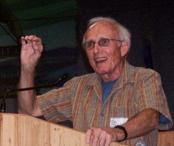 Jim Thatcher standing behind a lectern