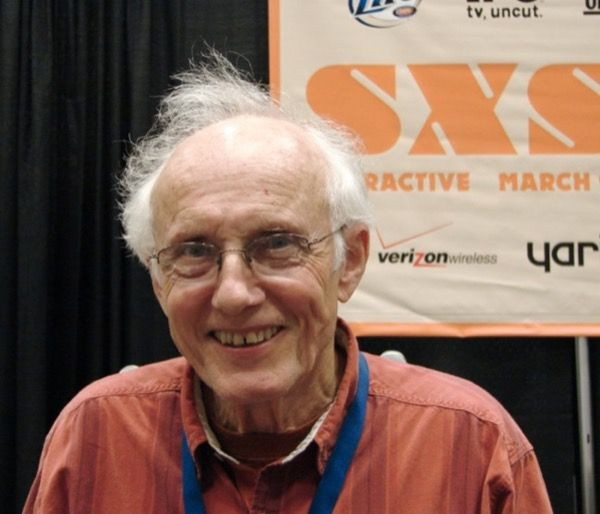 Jim Thatcher in front of a SXSW poster